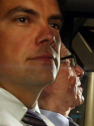 Different views: Lachlan Murdoch (left) was in London last week when his father, Rupert was grilled by MPs.