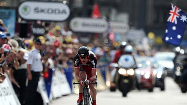 Cadel Evans powers down the finishing straight of last night's time trial to claim the yellow jersey in the Tour de France.