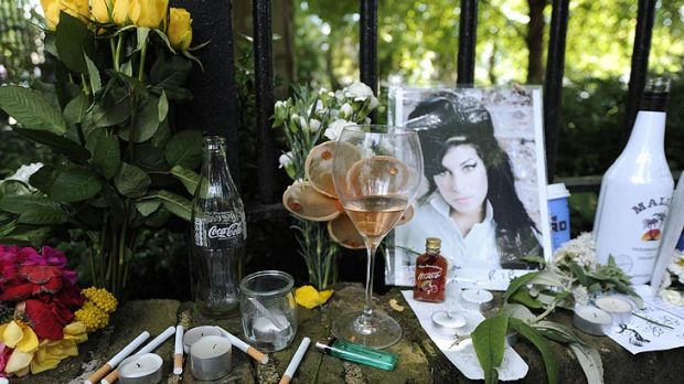 Booze and cigarettes ... Tributes to Amy Winehouse outside her London flat.