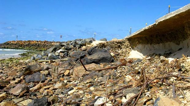 Washed away: Rocks and rusting steel are all that now remains of the once beautiful sandy beach at Kingscliff.