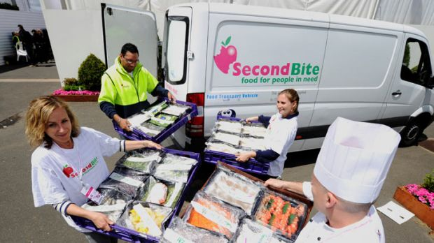 SecondBite workers collect leftover food from Birdcage Marquee at Flemington racecourse.