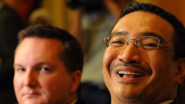 Malaysia's Home Affairs Minister Hishammuddin Hussein speaks at a joint press conference along with Australian ...