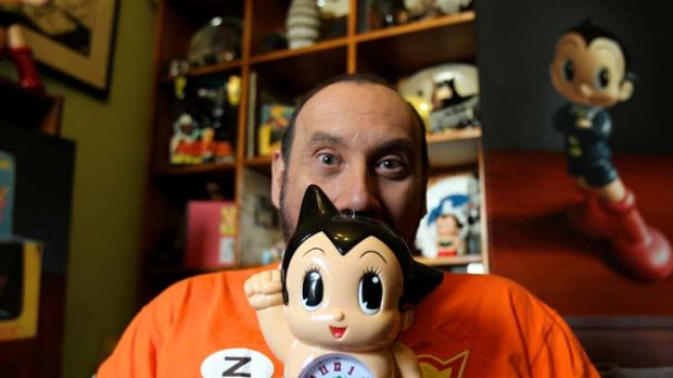 Nick Stathopoulos with the toy collection that inspired his latest exhibit <em>Toy Porn 2</em>.