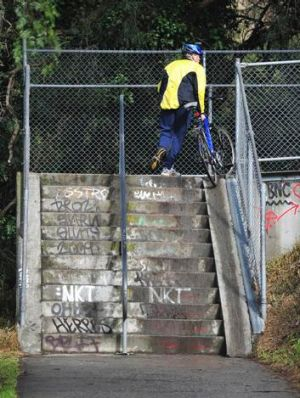 Cyclists forced to push their bikes up stairs to be able to continue on the bike path in Abbotsford.