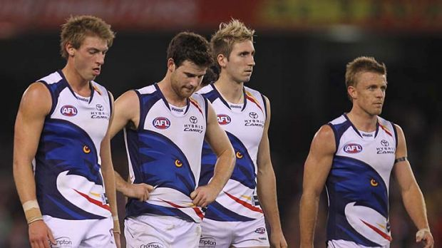 Crows players leave the crowd after being hammered by St Kilda.