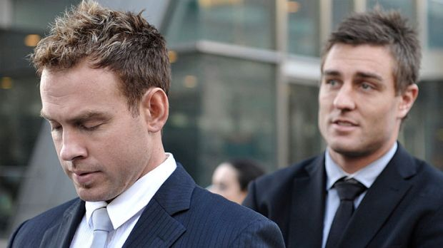 'Did you chop her?' ... Teammates Jason Gram and Sam Fisher leave court after giving evidence in the Lovett trial.