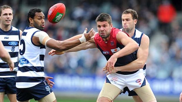 Surrounded: Melbourne ruckman Mark Jamar is hopelessly outnumbered by Geelong players.