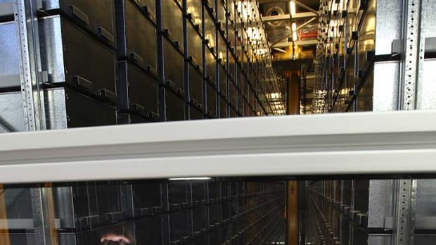 Beam me up ... project assistant Ambrose Wong in Macquarie University library's automated storage and retrieval system.