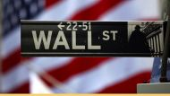 The Wall Street sign is seen outside the New York Stock Exchange, March 26, 2009. Stocks rose on Thursday, with the ...