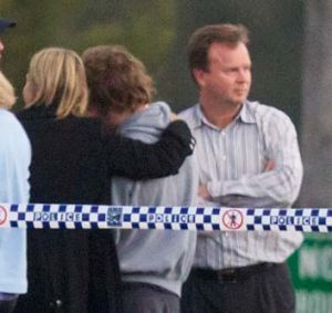 Madeleine's father, William Pulver, waits at the scene last night with shocked family and friends.