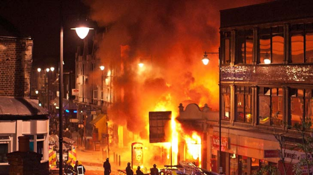 LONDON, ENGLAND - AUGUST 06:  Buildings burn on Tottenham High Road, London after youths protested against the killing ...