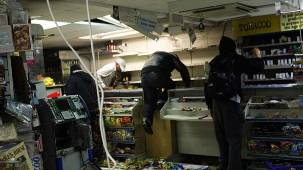 Looters rampage through a convenience store in Hackney.