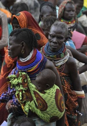 Desperate times ... women and children wait for food-aid distributions in Kenya, where food shortages have increased ...