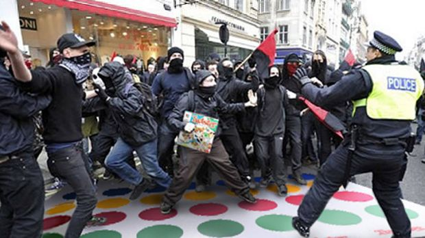 Fun and games .... Rioters and police play a game of Twister.