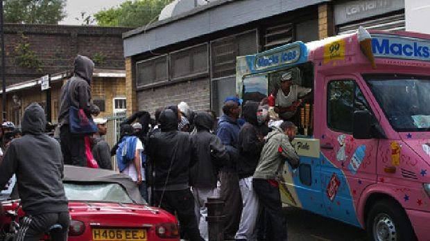Sugar rush ... Looters queue up for ice cream.