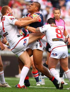 Mose Masoe of the Roosters runs into some solid Dragons defence.