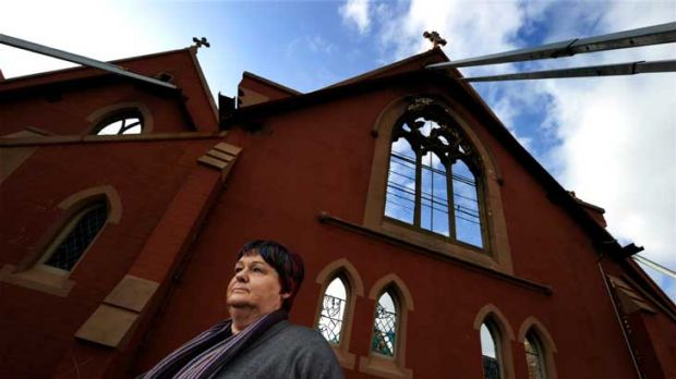 Save St Joseph's spokeswoman Mary Fenelon outside the propped-up shell of the church, gutted by fire in 2007, which she ...