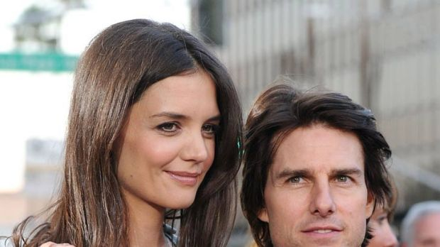 Tall order ... fans are questioning if Tom Cruise, pictured with wife Katie Holmes, has the stature for his new role.