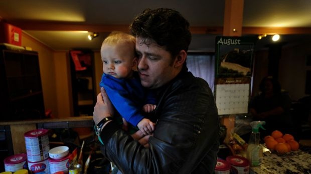 Jason Richards with his son Jonas Richards, 7 months. Jason's wife Kelly died in hospital after a routine operation. ...