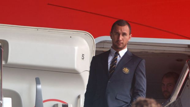 Familar faces ... Quade Cooper at Sydney Airport, where the 30-member Wallabies side for the World Cup was announced.