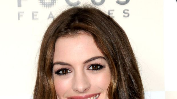 Rapt in rhyme ... Anne Hathaway vents her fury at the paparazzi.