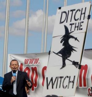 Tony Abbott distanced himself from the more offensive signs at the No Carbon Tax rally outside Parliament House.