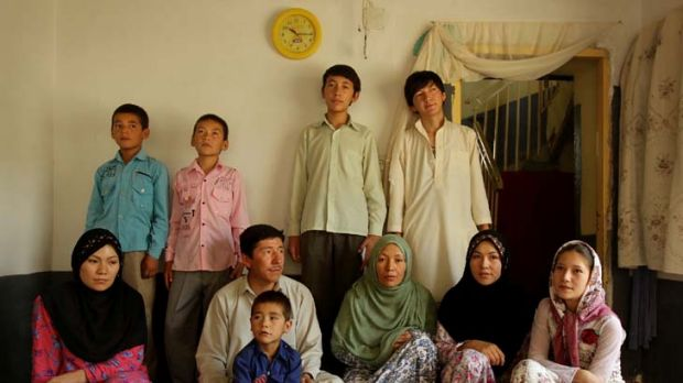 Fearful ... Mohammad Akbar Sohrabi, fourth from left, with members of his extended family in their rented home where he ...