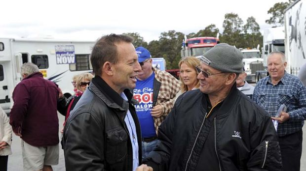 To address truck drivers' rally … the Opposition Leader, Tony Abbott, meets convoy protester Ken Wilkie at Marulan ...