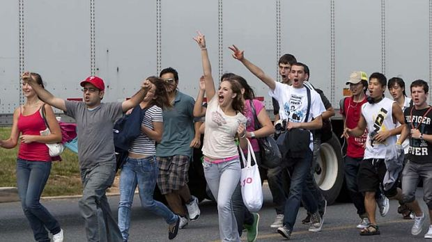 A group of foreign workers leave work to join a protest outside the Hershey's warehouse.