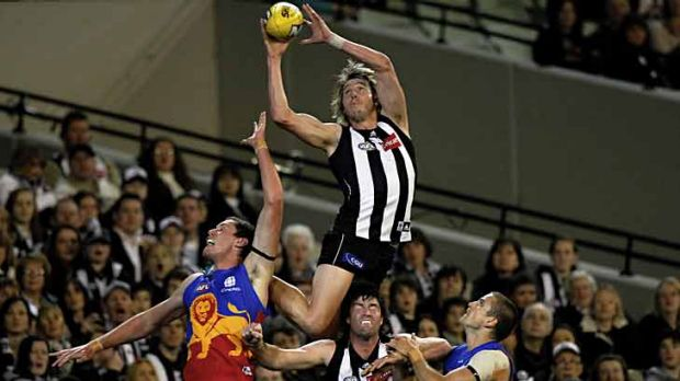 Dale Thomas soars for Collingwood during the 2011 AFL season.
