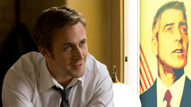 Gosling with Clooney as a poster, one of his many roles on <i>Ides of March</i>.