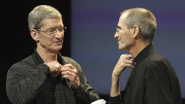 Outgoing Apple CEO Steve Jobs (right) appears on stage with his anointed successor, Tim Cook, at news conference at the ...