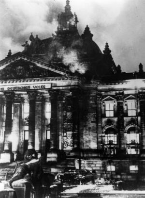 The Reichstag in flames during the Nazi ascent to power in Berlin.