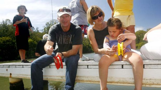 Charitable work ... Steve Waugh with occupational therapy lecturer Imelda Burgman, and Pangari Clark, 7, who has Rett ...