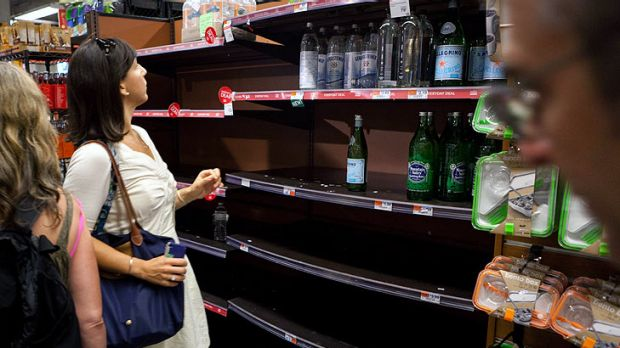 A shoppers hunt for water bottles at a downtown Manhattan supermarket where workers claim over 400 cases were purchased ...