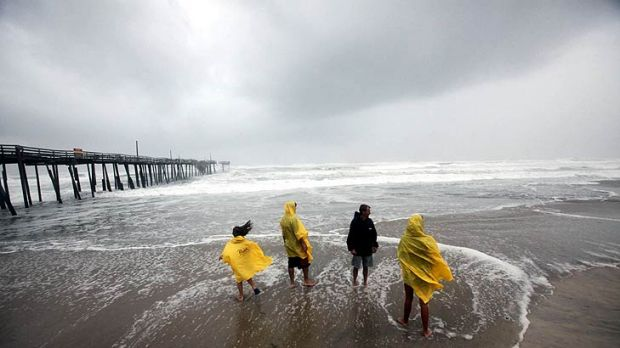 The first storm bands from Hurricane Irene arrive near the Frisco, North Carolina, pier.