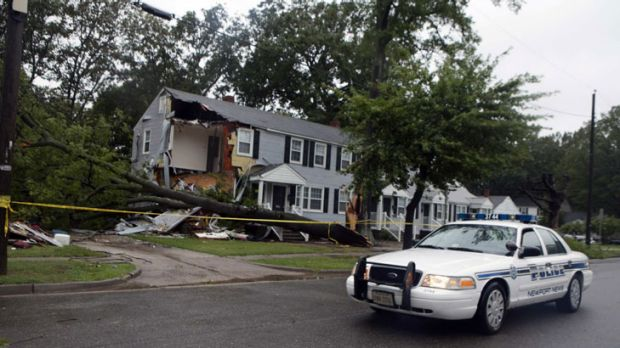 A police car passes the wreckage of an apartment block in Newport News, Virginia, where an 11-year-old boy died when a ...