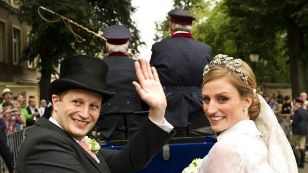 Prince Georg Friedrich of Prussia and Princess Sophie von Isenburg set off in a horse drawn carriage after their wedding ...