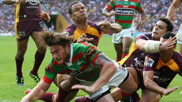 Chris McQueen of the Rabbitohs manages to burst through the Broncos' defence to score a try.
