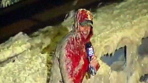Call of duty ... Local reporter Tucker Barnes continues his weather update despite being hit with waves of sewage.