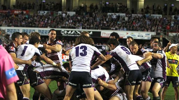Players from Manly and Storm forget about the game and let each other have it.
