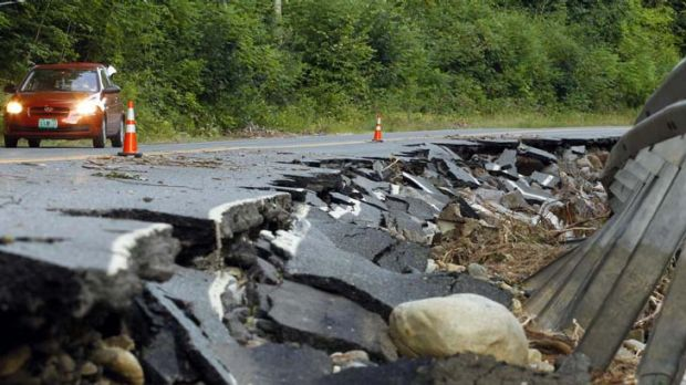 Big damage bill ... a section of Route 112 that was washed out during Hurricane Irene in Halifax, Vermont.