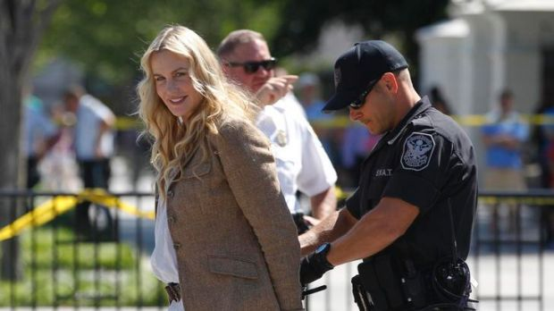 Clean energy advocate ... Daryl Hannah is arrested by police outside the White House.
