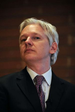 "Julian Assange hits back ... ""If Mr McClelland is unhappy ... perhaps he should consider cancelling my Australian ..."