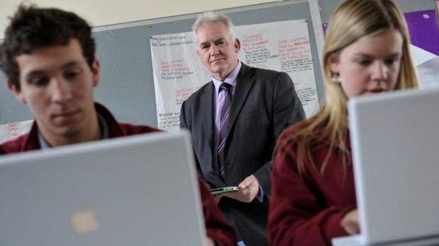 Ringwood Secondary College principal Michael Phillips, with students Dylan Hornsby and Kirsty Gayther, believes students ...