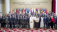 Heads of State and Foreign Affairs ministers who take part in a summit on the post-Kadhafi era pose for the official ...