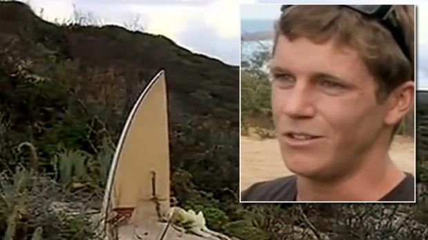 A memorial placed at Bunker Bay for the dead shark-attack victim, and inset, friend James Cottrell.