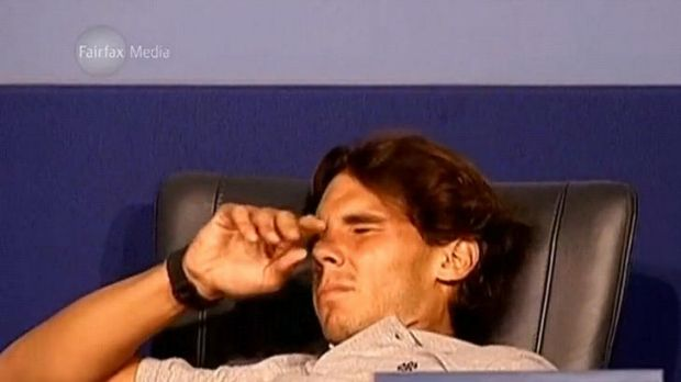 Going, going … Rafael Nadal succumbs to severe cramping at his post-match press conference.