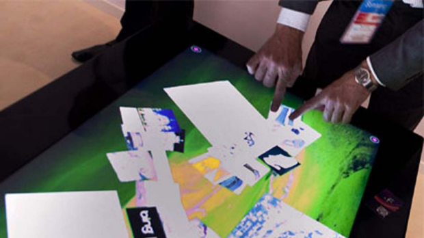 Interacting with Microsoft Surface version 2, built by Samsung.