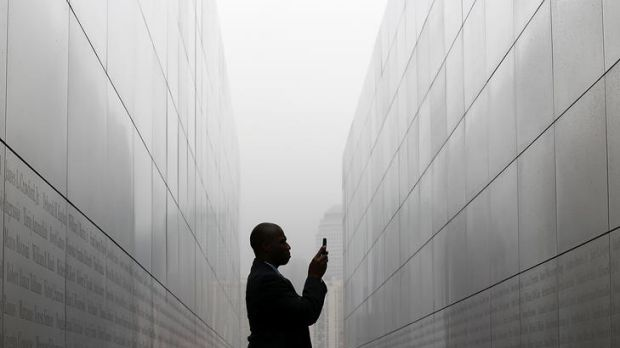 "Todd McCormick takes a photograph of names on the walls of the newly constructed ""Empty Sky Memorial"" at Liberty State ..."